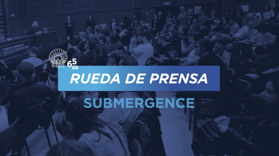 Press Conference ''Submergence'' (O.S.)